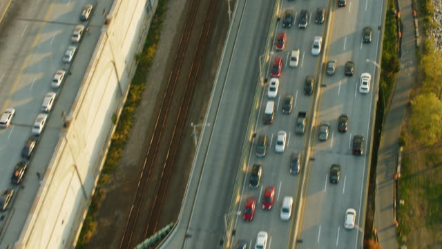 Aerial flying over West Side Highway at the end of day then camera pans up to NYC skyline