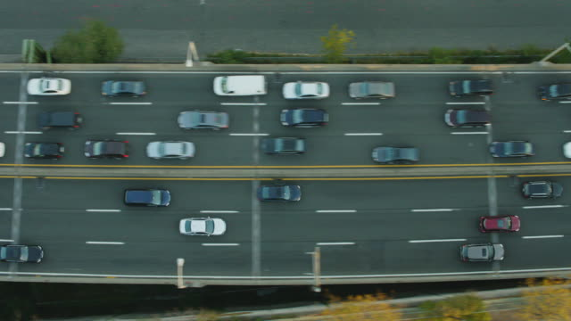 Aerial flying over West Side Highway looking directly down on moving traffic