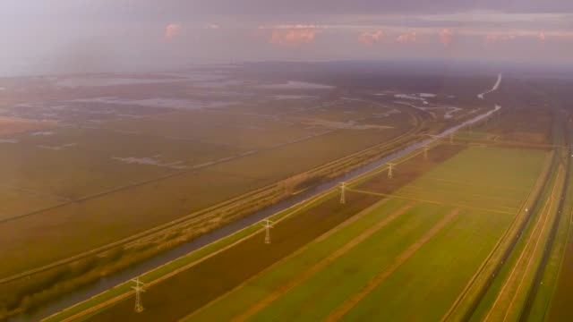 aerial flying over windmills next to road north of amsterdam, netherlands - open field stock videos & royalty-free footage
