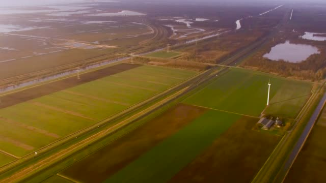 aerial flying over windmills next to road north of amsterdam, netherlands - netherlands stock videos & royalty-free footage