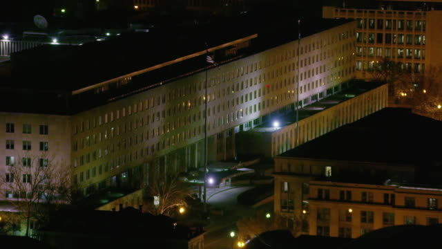 aerial flying past and zooming in on harry s. truman building, night - harry truman stock videos and b-roll footage