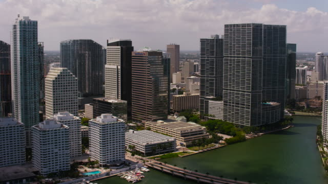 Aerial flying past buildings in Downtown Miami, FL