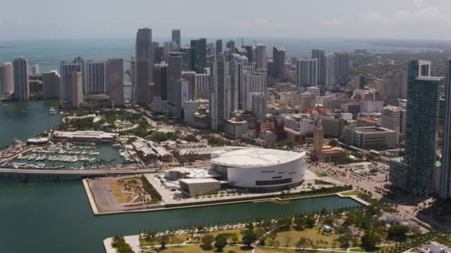 aerial flying past downtown miami, sunny day florida - miami stock videos & royalty-free footage