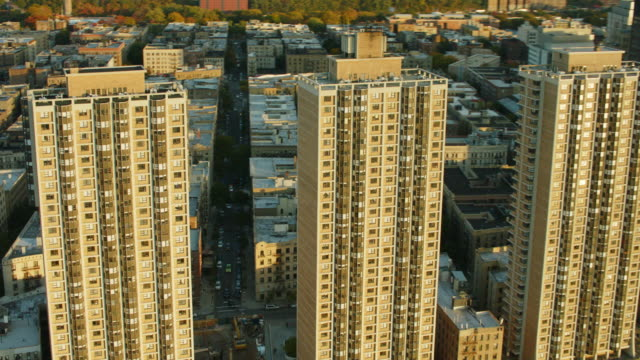 aerial flying past residential buildings along the hudson river in harlem - harlem stock videos & royalty-free footage