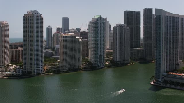aerial flying past the miami river and downtown miami, fl - canal stock videos & royalty-free footage