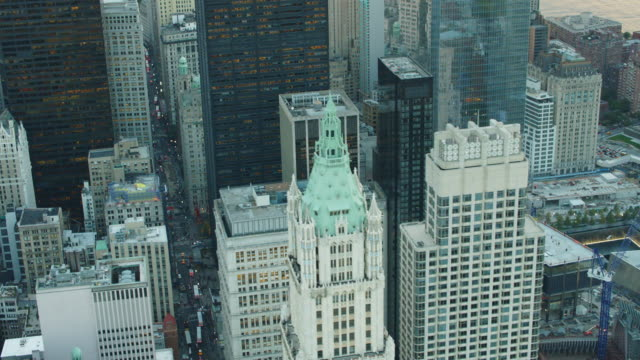 aerial flying past woolworth building and broadway with world trade and national september 11 memorial - woolworth building stock videos & royalty-free footage