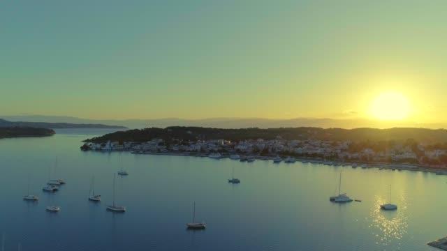 Aerial - flying sidewards above a small harbor at dusk - Porto Heli - Porto Cheli - Greece - Argolis - Argolida