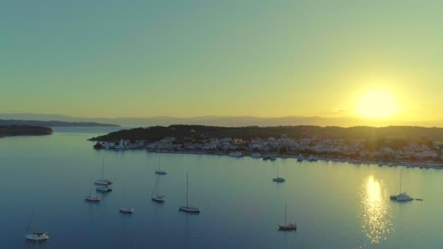 Aerial - flying sideways above a small harbor at dusk - Porto Heli - Porto Cheli - Greece - Argolis - Argolida