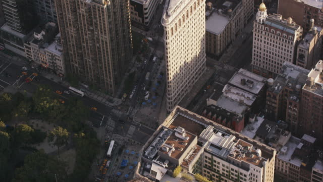 Aerial flying south down Broadway past Madison Square Park and the Flatiron Building, NYC