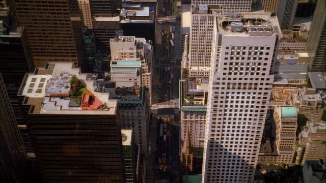aerial flying south over fifth avenue in midtown manhattan / view of downtown manhattan / nyc - fifth avenue stock videos & royalty-free footage