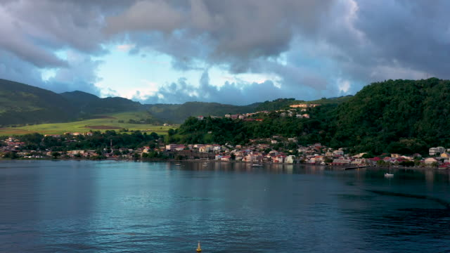 aerial flying towards caribbean town of saint-pierre in martinique, daytime - french overseas territory stock videos & royalty-free footage