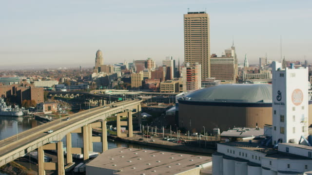 aerial flying towards city of buffalo over skyway and river, daytime usa - buffalo new york state stock videos & royalty-free footage