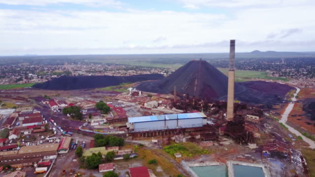 Aerial flying towards copper mine, daytime Lubumbashi, Congo, Africa