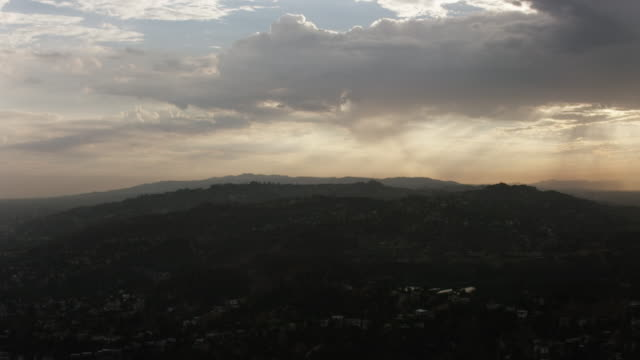 aerial flying towards hollywood reservoir los angeles, ca sunset - reservoir stock videos and b-roll footage