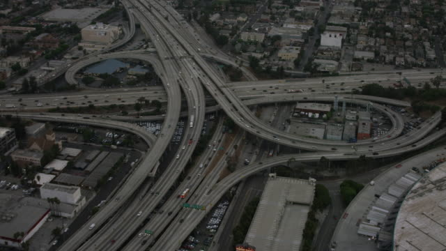 Aerial flying towards interchange in Los Angeles, CA morning