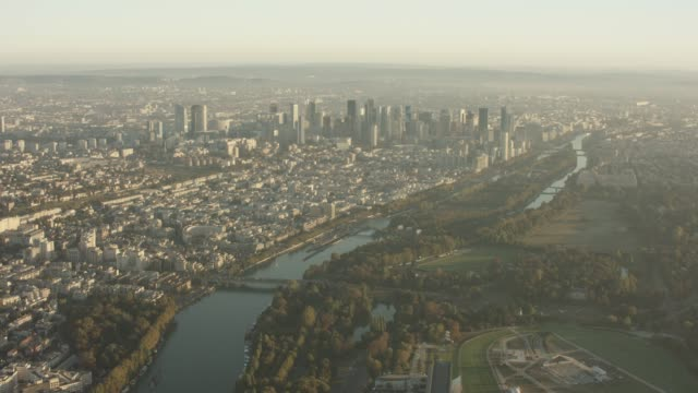 aerial flying towards la defense over the bois de boulogne in paris france, morning - cityscape stock videos & royalty-free footage