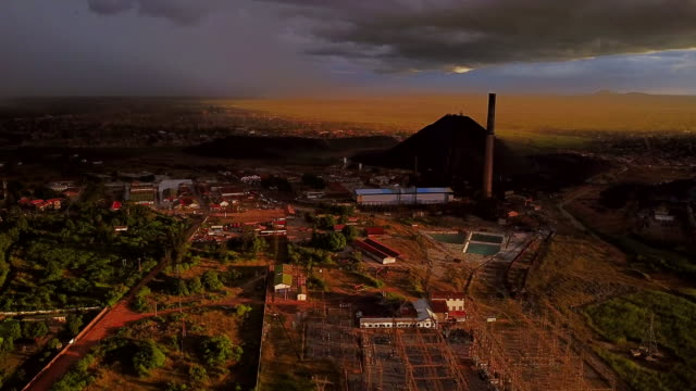 aerial flying towards mampala de la gecamine copper mine, lubumbashi, congo, africa - bergbau stock-videos und b-roll-filmmaterial