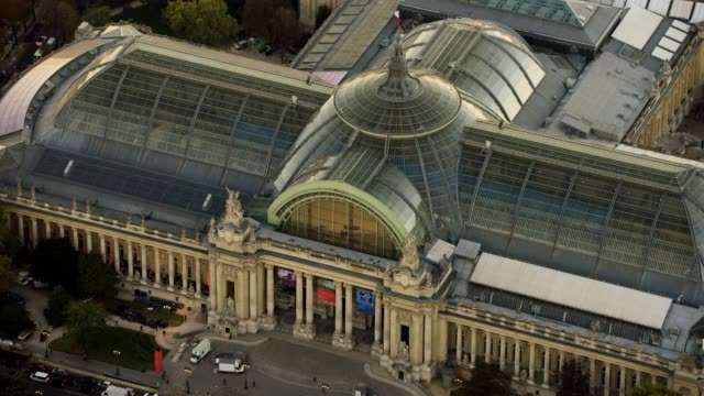 aerial flying towards the grand palais in paris france - grand palais stock-videos und b-roll-filmmaterial