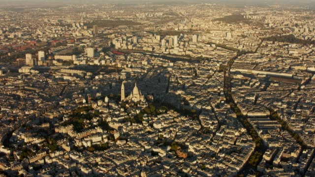 aerial flying towards the sacré-cœur in paris france, sunset - christentum stock-videos und b-roll-filmmaterial