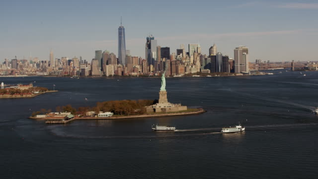 Aerial flying towards The Statue of Liberty National Monument, view Manhattan