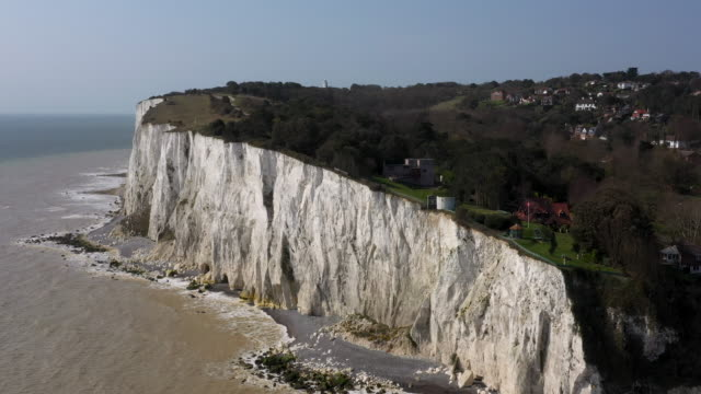 aerial flying towards the white cliffs of dover, daytime - kent england stock videos & royalty-free footage