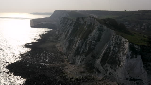 aerial flying towards the white cliffs of dover, daytime - 30 seconds or greater stock videos & royalty-free footage