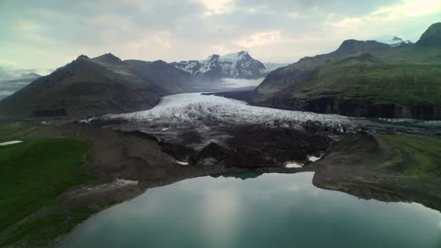 aerial flying towards vatnajokull glacier in iceland - icecap stock videos and b-roll footage