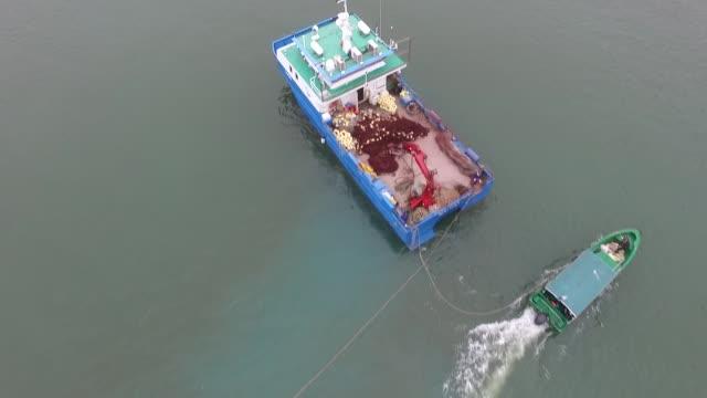 aerial flyover of boats in silvermine bay lantau island hong kong no - lantau stock videos and b-roll footage