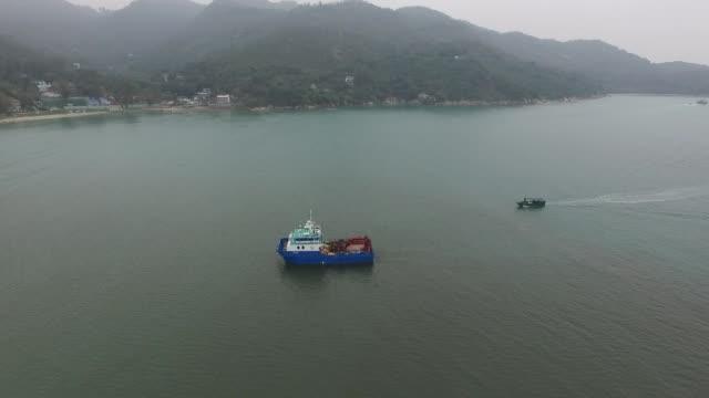 aerial flyover of boats in silvermine bay lantau island hong kong - lantau stock videos and b-roll footage