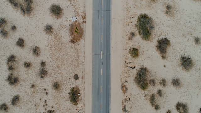 aerial flyover of desert road - nevada stock videos & royalty-free footage