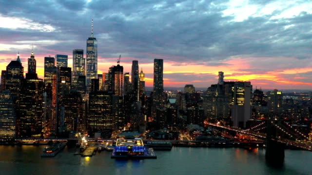 aerial flyover of new york skyline at night - skyline stock videos & royalty-free footage