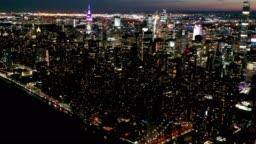 Aerial Flyover of New York Skyline at Night