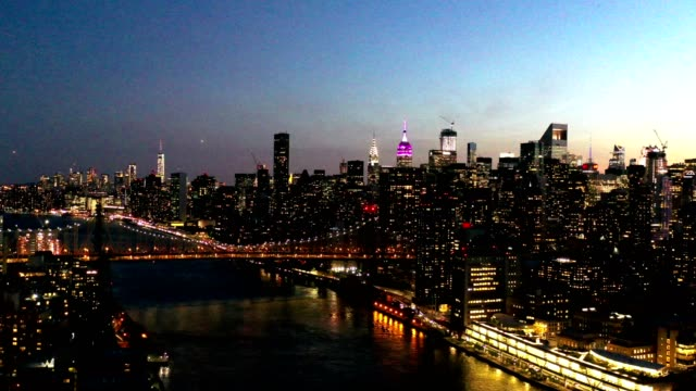 aerial flyover of new york skyline at night - dusk stock videos & royalty-free footage