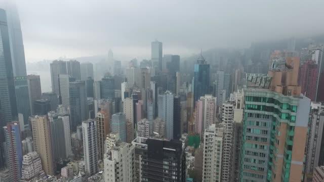 aerial flyover of of hong kong island buildings. no audio - hong kong island stock videos & royalty-free footage