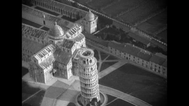 aerial flyover of pisa / vs ground level view pisa cathedral with leaning tower behind /vs flyover the cathedral and leaning tower / vs pan down and... - pisa cathedral stock videos & royalty-free footage