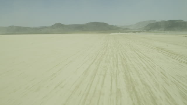 Aerial Flyover off-road vehicle in Desert