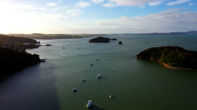 aerial flyover view of boats in ocean near islands / paihia, new zealand - bay of islands new zealand stock videos & royalty-free footage