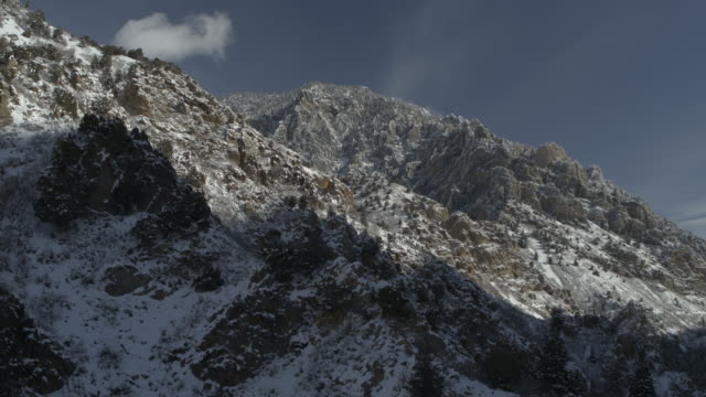 aerial flyover view of remote mountain landscape in winter / american fork canyon, utah, united states - american fork canyon stock videos and b-roll footage