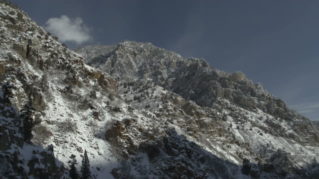aerial flyover zoom out of remote mountain landscape in winter / american fork canyon, utah, united states - american fork canyon stock videos and b-roll footage