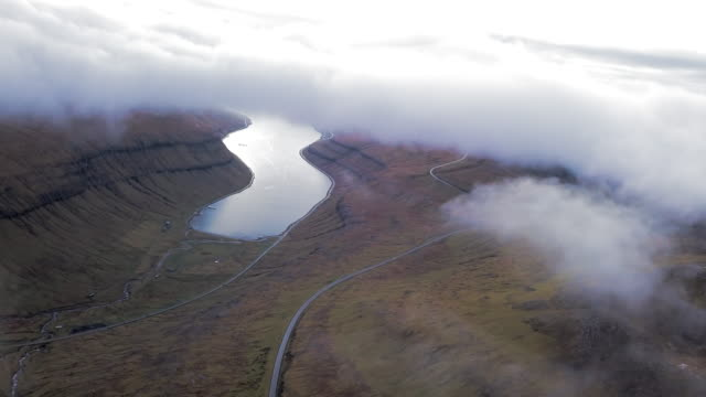 aerial: foggy island with an inlet of water - inlet stock videos & royalty-free footage