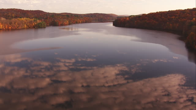Aerial Follow Hudson River with Cloud Reflections