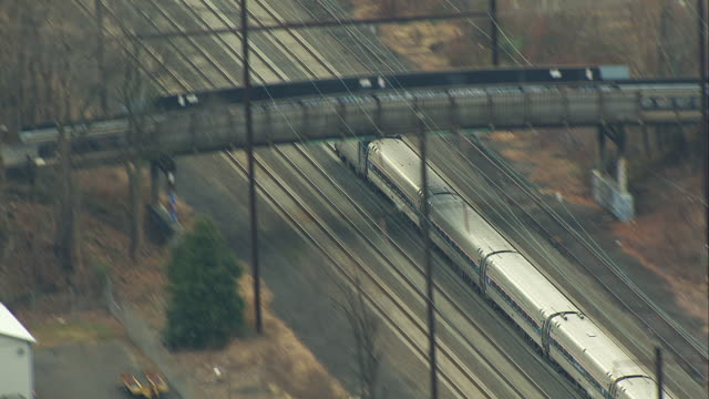 aerial follow passenger train in suburbs - moving past stock videos & royalty-free footage