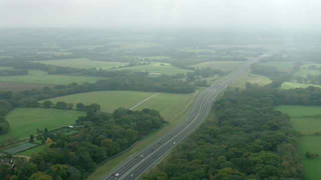 aerial following black sedan on london expressway - pull out camera movement stock videos & royalty-free footage