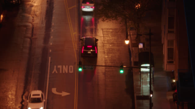 aerial following black suv thru chicago, il city streets - night - sports utility vehicle stock videos & royalty-free footage