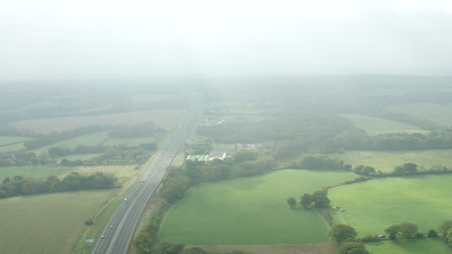 aerial following traffic on london expressway - pull out camera movement stock videos & royalty-free footage