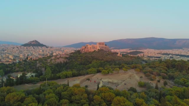 Aerial footage - Acropolis of Athens and the hill of Filopappou at sunset - Greece - View of Athens from the