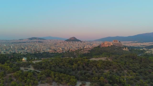 Aerial footage - Acropolis of Athens and the hill of Filopappou at sunset - Greece
