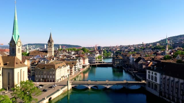 aerial footage along the limmat river in zurich old town, switzerland - jetty stock videos & royalty-free footage