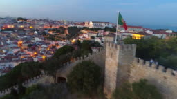Aerial footage ancient fortress in Lisbon at sunset