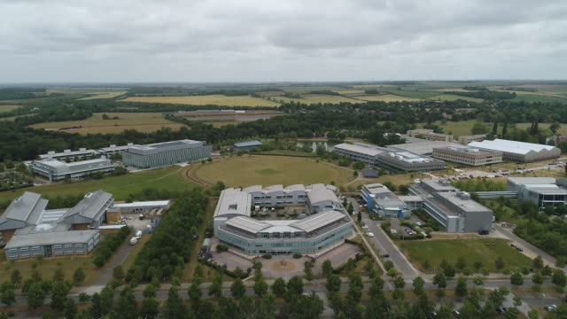 aerial footage and static shots of astrazeneca premises in cambridge uk on monday june 8 2020 - horizon over land stock videos & royalty-free footage